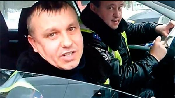 Миняйло говорит, что фамилии нападавших - Бакай и Полищук (на фото)