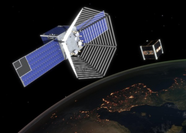 Компьютерный рендер сближения спутников на орбите.