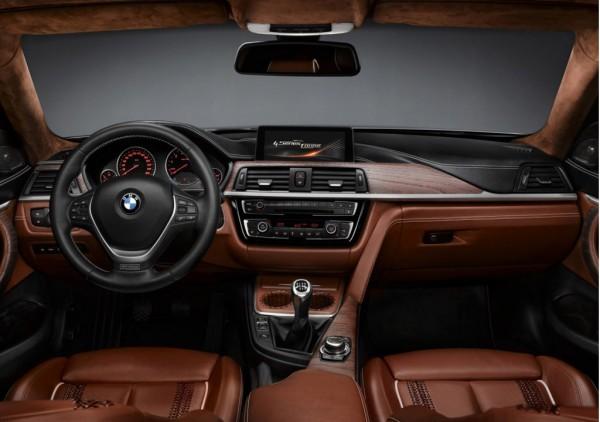 Интерьер четверки BMW целом копирует третью серию
