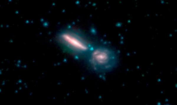 Две сливающиеся галактики Arp 302