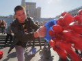 TomatoBucketChallenge. На Майдане фото депутатов забросали помидорами
