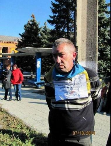 """На Донбассе террористы привязали мужчину к столбу и назвали его """"карателем"""""""