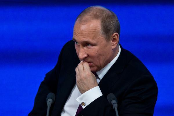 Путин после ответа на вопрос о Крыме