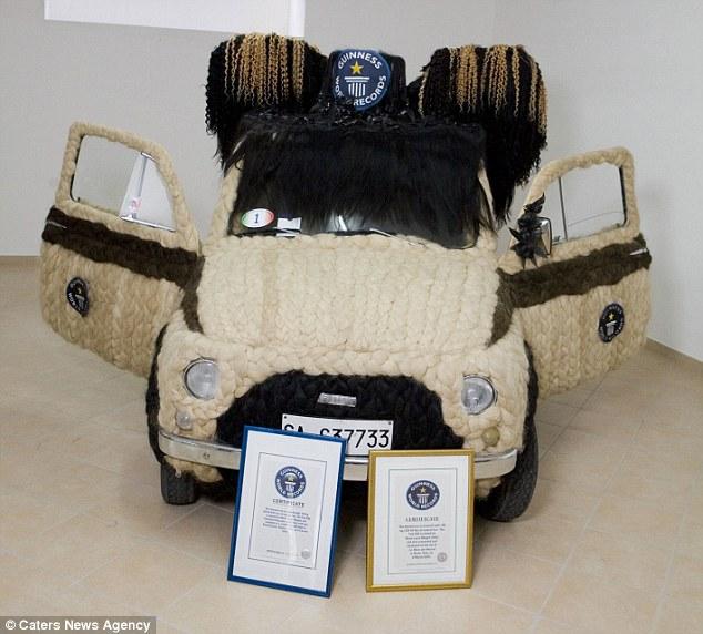 Машина с сертификатами от книги Гиннеса