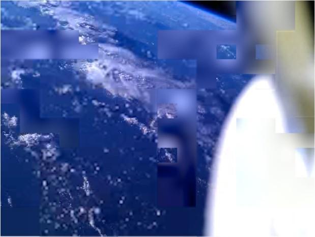 Фотография Земли с орбиты, снятая спутником PhoneSat. Получилась не лучшего качества, но зато цель достигнута