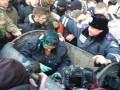 В Харькове депутата горсовета бросили в мусорный бак