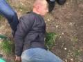 В Киеве со стрельбой задержали валютных мошенников