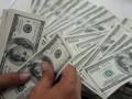 Доллар подешевел на