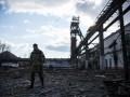 Захваченные боевиками заводы закрываются, ситуация близка к критической - Коммерсант