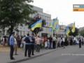 На фейковом митинге против войны на Донбассе заметили фото из Грозного