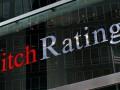 Fitch снизило рейтинг России до негативного