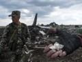 Сбитый в Луганске самолет окружили боевики: фото с места крушения