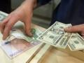 Нацбанк опустил гривну ниже 27 грн за доллар