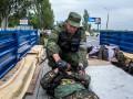 День в фото: бои между батальонами Восток и Донбасс и обещания Путина