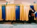 Выборы президента 2014: длинные очереди, политики на участках и разбитые урны  (фото)