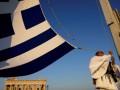 Fitch понизило прогноз по кредитному рейтингу Греции