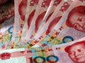 Народный банк Китая ослабил курс юаня
