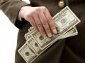 Доллар незначительно подешевел к закрытию межбанка