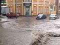 Умань залило дождем и засыпало градом