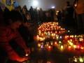 В Киеве в память о погибших из лампадок выложили слово