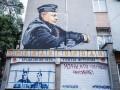 В Крыму под муралом с Путиным появились изображения Сенцова и Кольченко