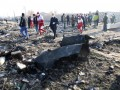 Обломки самолета МАУ свезли в ангар - Иран