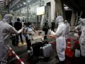 В аэропорту Шанхая отменили все рейсы после COVID-19 у грузчиков
