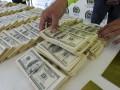 Курс доллара стабилизировался к закрытию межбанка