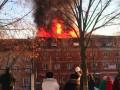 На Подоле в Киеве 15 пожарных машин тушат трехэтажный дом