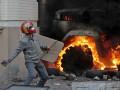 День в фото: Столкновения в Киеве и поджог КГГА