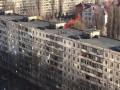 Дети в Киеве играют, бегая по крышам высоток
