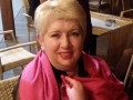 Депутат Бучи обматерила и избила сумкой горожан