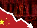 Народный банк Китая снова снизил курс юаня