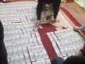 Под Киевом у чиновника-взяточника изъяли более 120 тысяч долларов