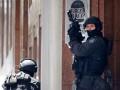 Полиция Сиднея расследует причины гибели заложников в кафе