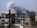 Меркель и Макрон призвали РФ повлиять на Асада