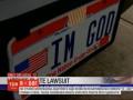 """Американец в суде отстоял право ездить с номерами """"Я - Бог"""""""