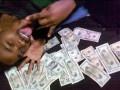 За фото с деньгами мужчине грозит 11 лет тюрьмы (ФОТО)