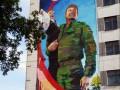 На корпусе Донецкого университета появилось граффити боевика и ребенка