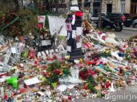 Свечи, портреты и горы цветов: как выглядят места терактов в Париже