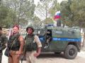 Эрдоган передал Путину фото российских военных с курдами