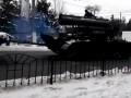 Боевики военной техникой повредили авто на улице Донецка - очевидцы