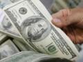 В обменных пунктах курс доллара вырос на 5 копеек - до 11,74 гривен