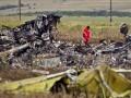 День в фото: сбитый Боинг, бои в Донецке и