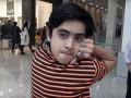 Пакистанский мальчик-сова может поворачивать голову на 180 градусов