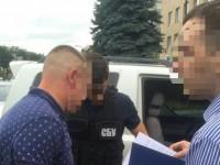 В Киеве за вымогательство $5 тысяч взятки задержан полицейский