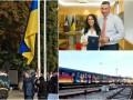 День в фото: Флаг Украины на Софийской площади, поезд-мурал в метро Киева и квартира для Джамалы