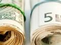 Евро подешевел до минимума к доллару за 12 лет