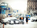 День в фото: снегопад в Киеве, Керри в Украине и прощание с Кузьмой