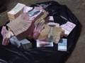 Полицейские нашли часть денег, украденных у супругов возле автосалона в Киеве